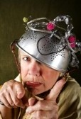 4618597-crazy-woman-wearing-a-metal-colander-for-a-helmet